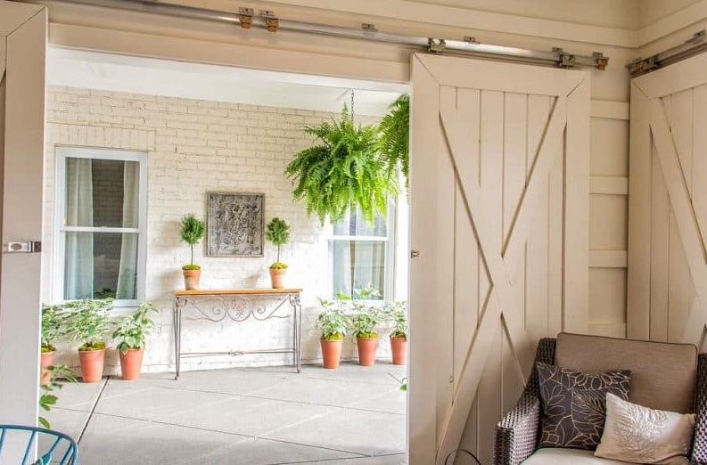 hanging flower basket ideas - Ferns by the Sliding Doors